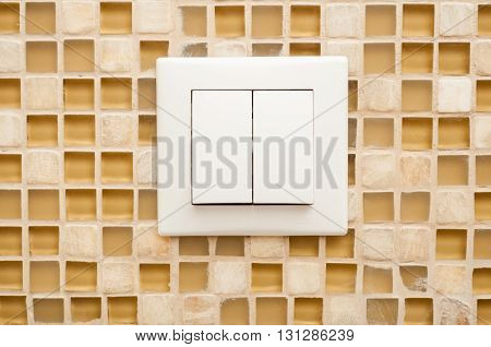Close-up Of Light Switch On Mosaic Wall