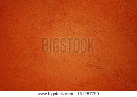 Background Made of Painted Wall in Ocher Color with Vignette