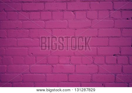 Background from Old Brick Wall Freshly Painted in Purple Color with Vignette