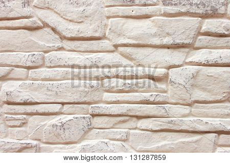 Background of Decorated Brick Wall Whitewashed with Cream Color Paint