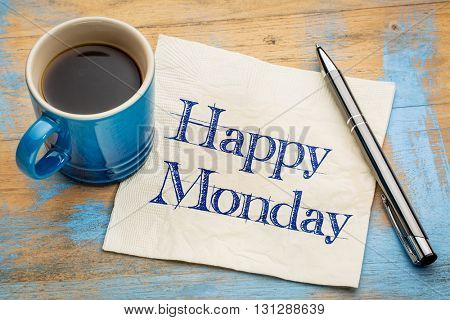 Happy Monday -  cheerful handwriting on a napkin with a cup of coffee
