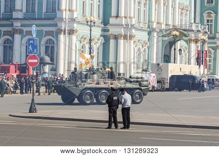 St. Petersburg, Russia - 9 May, Infantry fighting vehicle on the background of the Winter Palace, 9 May, 2016. Festive military parade on the Palace Square in St. Petersburg.