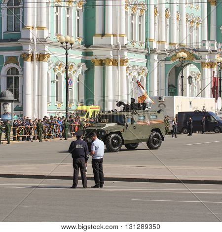 St. Petersburg, Russia - 9 May, Light armored vehicle under the flag, 9 May, 2016. Festive military parade on the Palace Square in St. Petersburg.