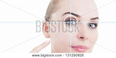 Close-up Portrait Of Young And Beautiful Woman Pointing To Eye
