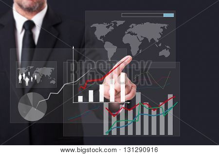 Business Man Touching A Global Chart Icon On Virtual Screen