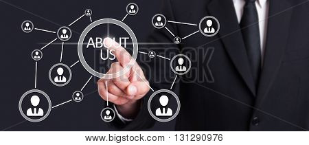 Businessman Touching Interface With Social Icons On Touchscreen