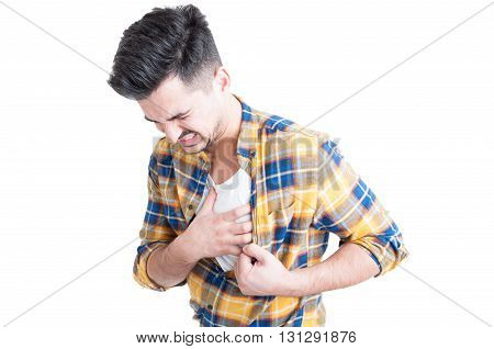 Young Man Holding Hand To His Chest During Heart Attack
