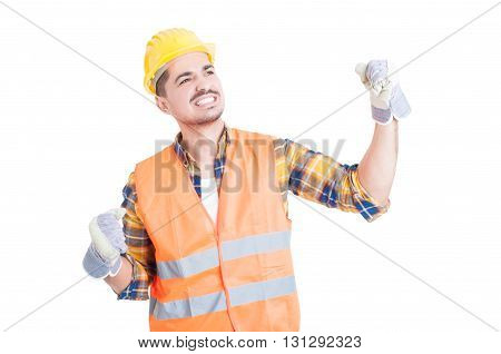 Young Cheerful Constructor Wearing A Hardhat And Punching The Air
