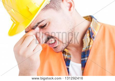 Concept Of Frustration With An Engineer With Headache In Closeup