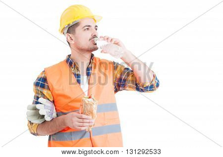 Portrait Of Young Engineer Eating A Sandwich And Drinking Water
