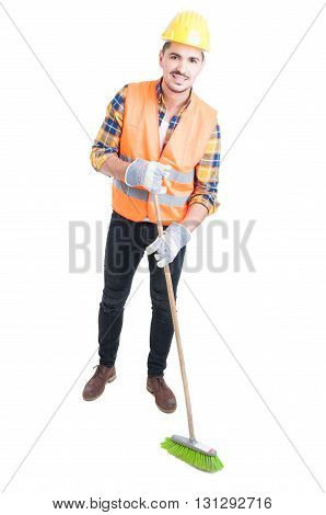 Cheerful Engineer Sweeping The Floor With A Broom