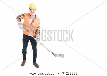 Happy engineer holding a shovel as digging concept with copy space isolated on white background