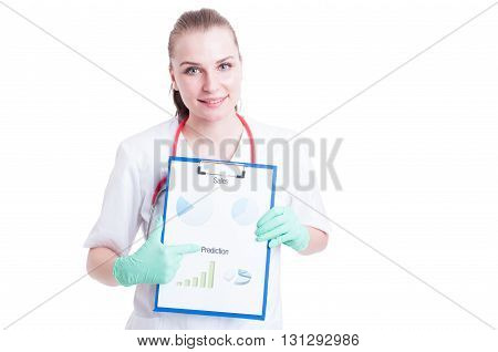 Cheerful Young Female Doctor Showing Clipboard With Diagram