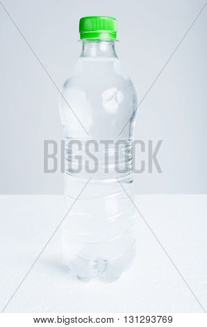 Plastic bottle of purified drinking water as hydration and refreshment concept isolated on white background
