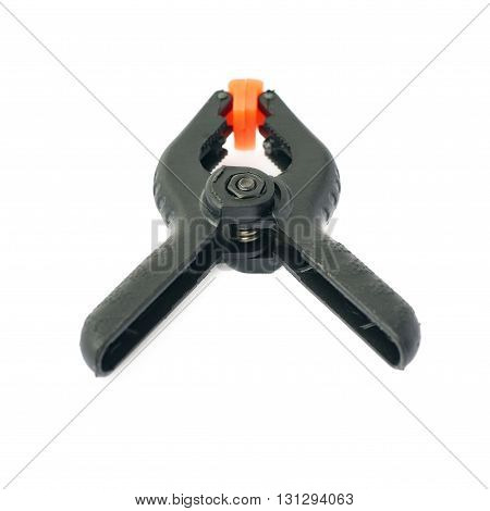 Pair of black clamp with orange plastic jaws, isolated over the white background