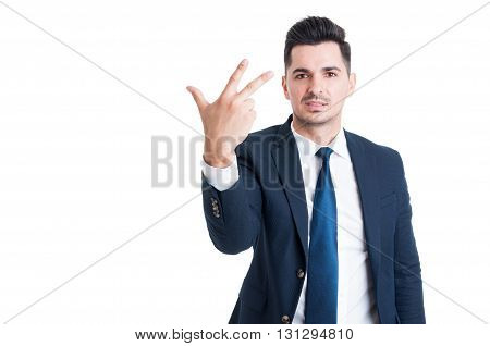 Smiling Businessman Or Sales Man Showing Number Three
