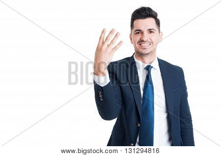 Smiling Businessman Or Sales Man Showing Number Four