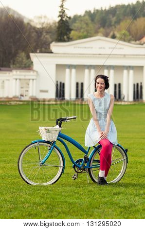 Portrait Of Happy Hipster Woman Enjoying Spring On A Bicycle