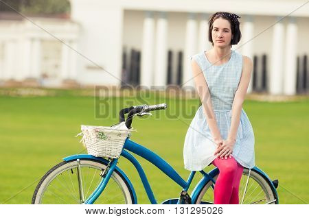 Summer Activity Concept With Attractive Woman Standing On Bicycle