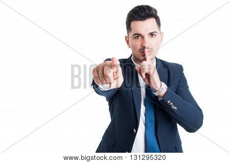 Confident Businessman Making Keep A Secret And Silence Gesture