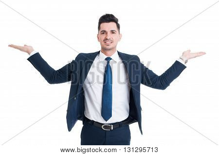 Businessman Holding Palms Up As Scale Or Balance