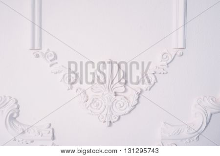 Stucco element of architectural decoration on the wall.