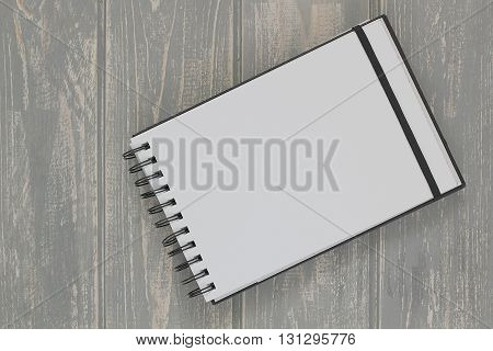 Note book on grey wooden desk. Top view.
