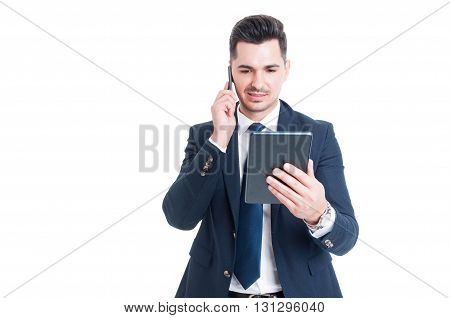 Confident Businessman With Modern Tablet Is Talking On Cellphone