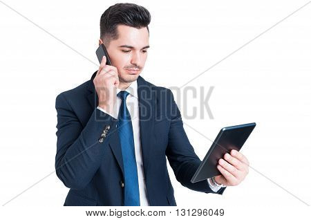 Attractive Young Businessman Working Using Cellphone And Digital Tablet