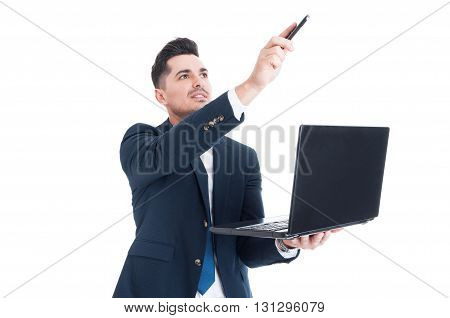 Portrait Of Attractive Businessman Holding Laptop And Pointing Up