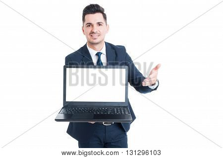 Cheerful Smiling Salesman Showing Laptop With Blank Screen