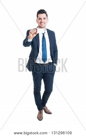 Full Body Of Cheerful Young Businessman Showing Blank Business Card
