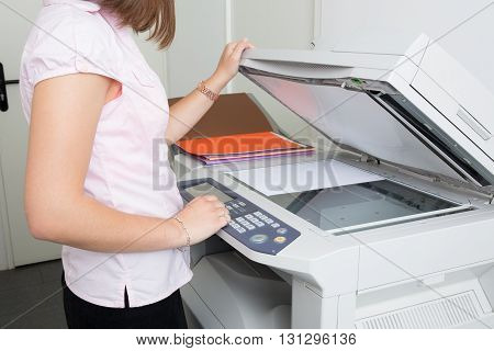 Young Secretary Using A Copy Machine At Office