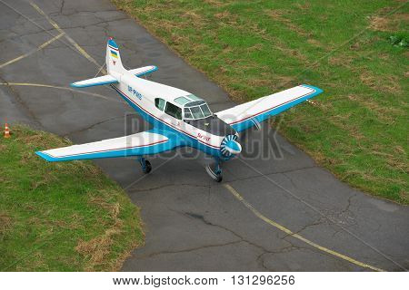 Zhitomir Ukraine - June 7 2014: Yakovlev Yak--18T light plane taxiing along the airfield to the runway for takeoff