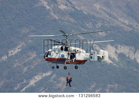 Gelendzhik Russia - September 9 2010: Kamov Ka-32 rescue helicopter in flight during the training operation over the sea