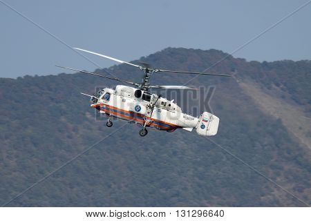 Gelendzhik Russia - September 9 2010: Kamov Ka-32 rescue helicopter in flight with mountains on the background