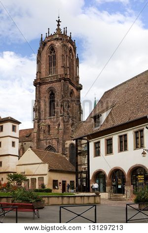 SELESTAT, FRANCE - SEPTEMBER 08, 2010: Selestat cityscape with the St. George's Church. Selestat is a commune in the Bas-Rhin department in Alsace France. The Gothic St. George's Church was founded in 1452. It is the church of exceptional size and quality