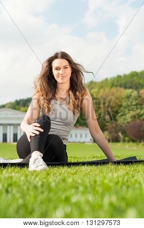 Healthy Beautiful Woman Practicing Pilates In The Nature