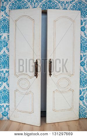 white old wooden door in the room of building.