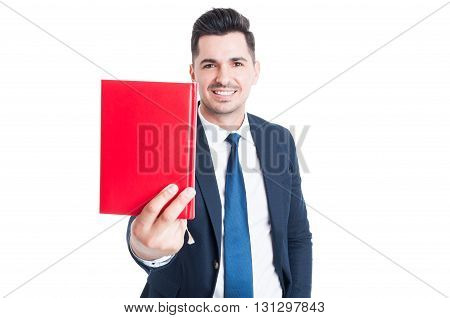 Cheerful Attractive Businessman Giving A Book And Smiling