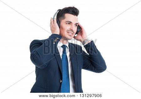 Successful Handsome Businessman Listening And Enjoying Music On Headset