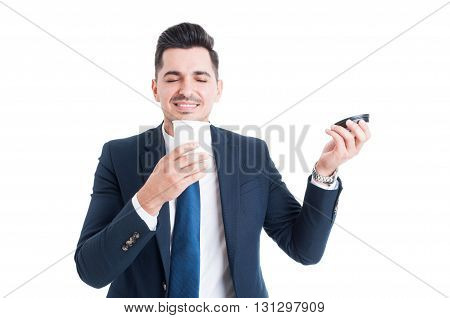 Handsome Happy Salesman Smelling A Cup Of Fresh Coffee
