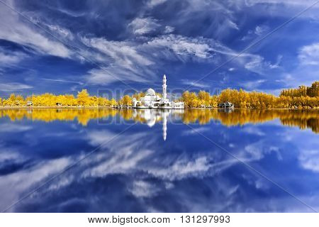 Beautiful View Of Mosque By The Lakeside In Infrared With Full Reflection.