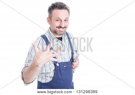 Repairman holding mechanical tools and showing five fingers or counting five with copyspace isolated on white