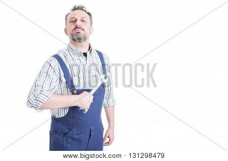 Portrait Of Attractive Male Mechanic In Blue Overalls Holding Wrench
