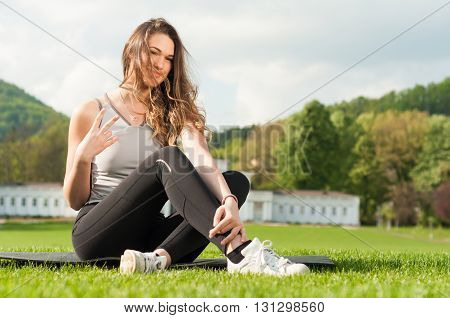 Young Woman In Sportswear Doing Peace Or Victory Gesture