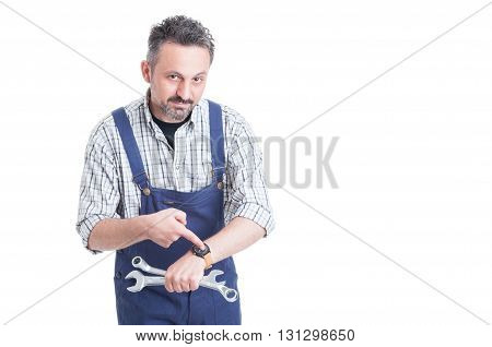 Attractive Young Repairman Pointing Finger On His Watch