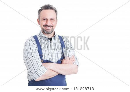 Trustworthy Cheerful Mechanic Holding Wrench And Posing With Arms Crossed