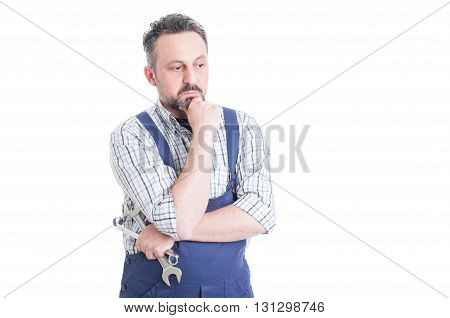 Thoughtful Man Portrait With Young Mechanic Looking Worried