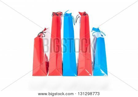 Shopping paper bags in different size and colors isolated on white background